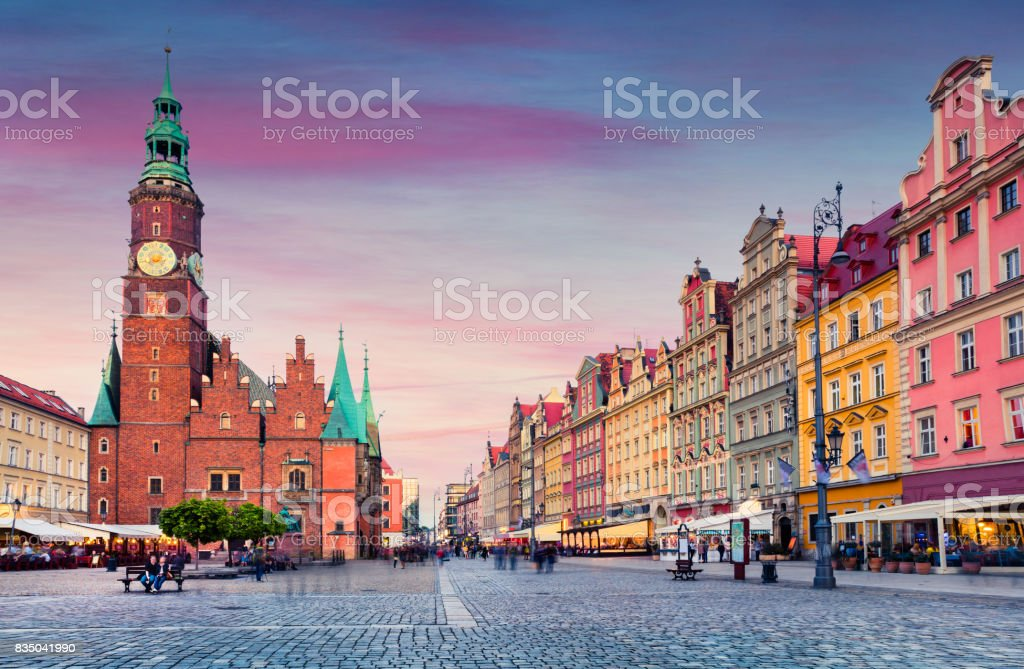Colorful evening scene on Wroclaw Market Square with Town Hall. stock photo