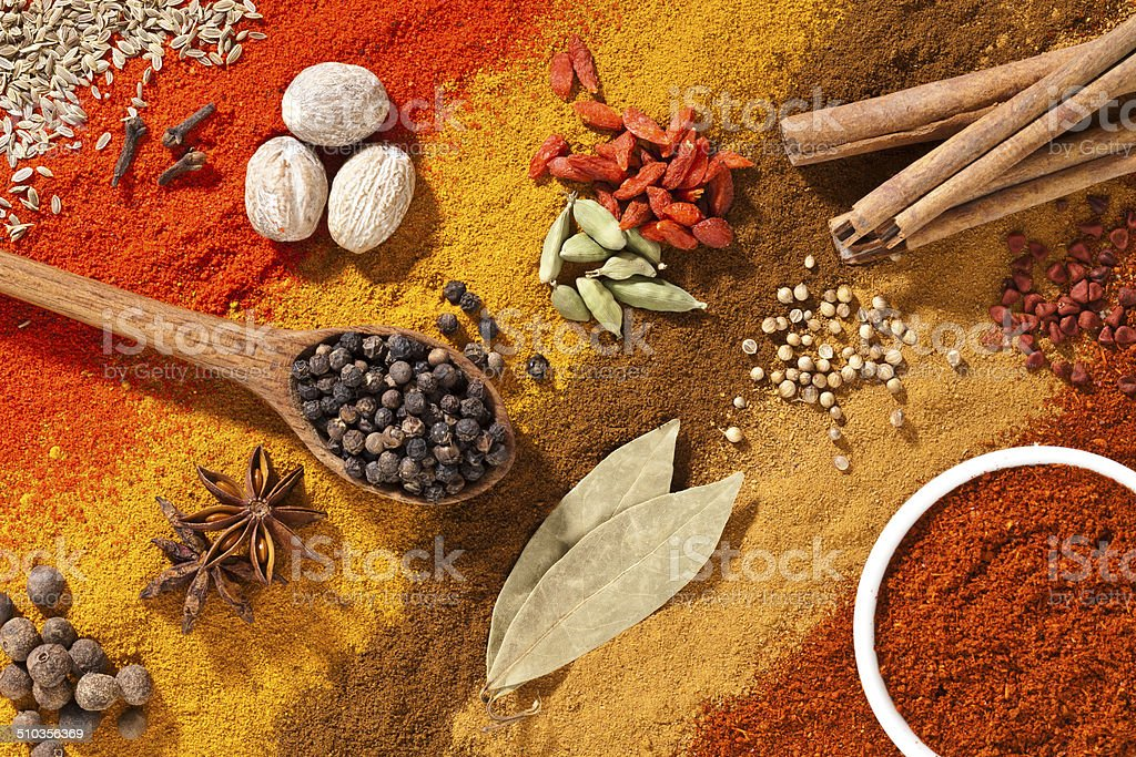 Colorful exotic spices composition shot directly above stock photo