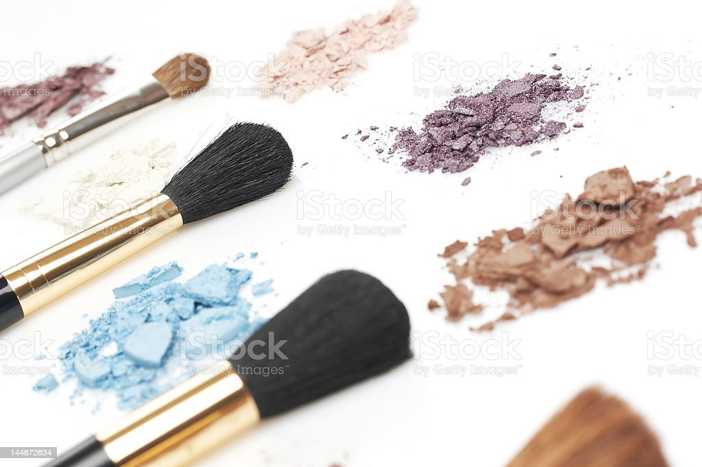 colorful eyeshadow and thick cosmetic brushes royalty-free stock photo