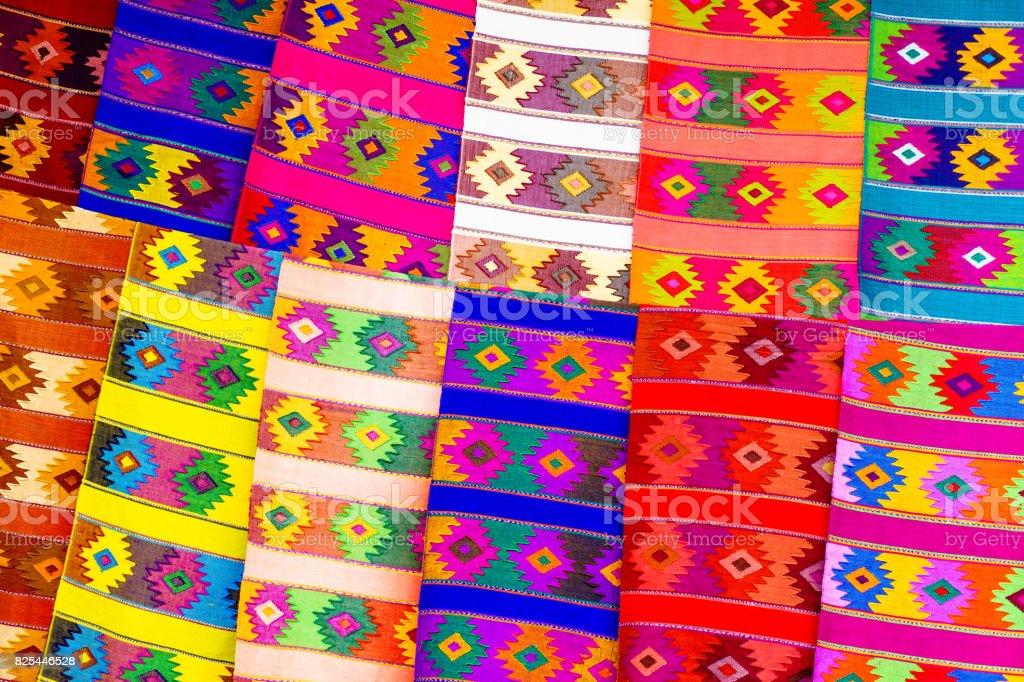 Colorful fabrics on market in Chichicastenango stock photo