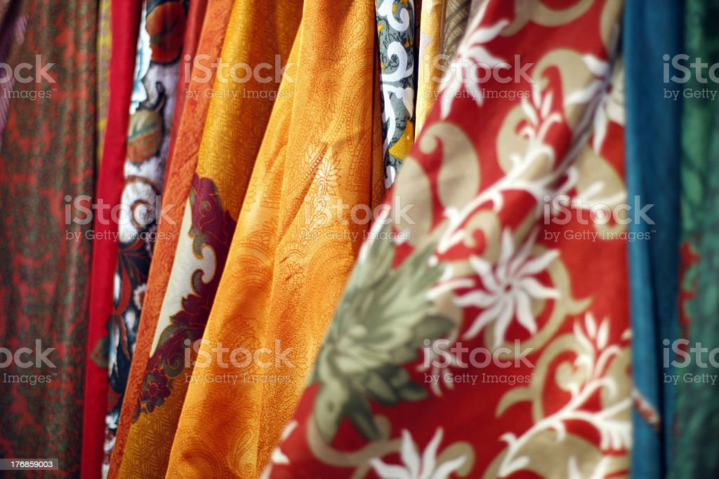 Colorful fabrics sold at an open market royalty-free stock photo