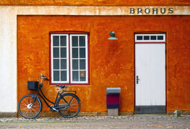 Colorful facade with an old bicycle stock photo