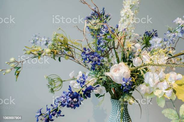 Colorful fake flowers in a vase on the table colorful green and blue picture id1063697904?b=1&k=6&m=1063697904&s=612x612&h=7vzmuui9hsgl6lear1vhdz  wq4yqsog5rfa1ppwpm4=