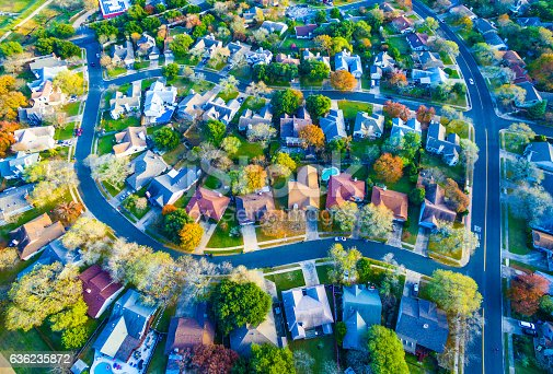 istock Colorful Fall Aerial Homes in Modern Suburb 636235872
