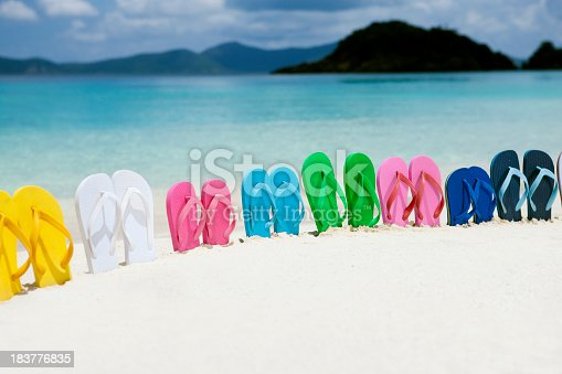 istock colorful family sandals in white sand on a Caribbean beach 183776835
