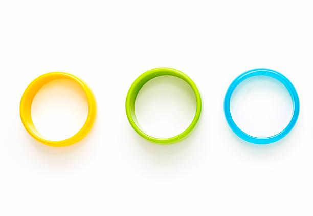 Colorful fashion bracelets on woman hand on white background. stock photo