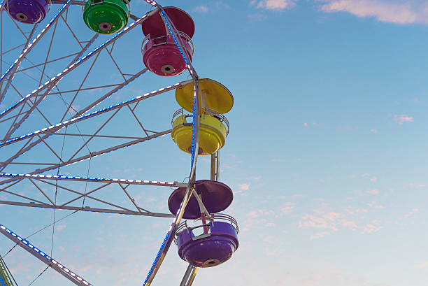 Colorful ferris wheel at fair during summer stock photo