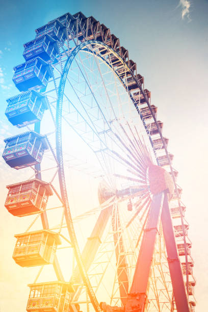Colorful Ferris Wheel Background at the Oktoberfest in Munich Colorful Ferris Wheel Background at the Oktoberfest in Munich ferris wheel stock pictures, royalty-free photos & images