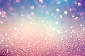 Blue pink and purple Lights Festive background. Abstract holiday twinkled bright background with natural bokeh defocused white lights. Party abstract background.