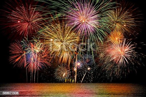 istock Colorful firework celebration on dark night sky background. 588621508