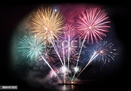 istock Colorful firework display for celebration 868481630