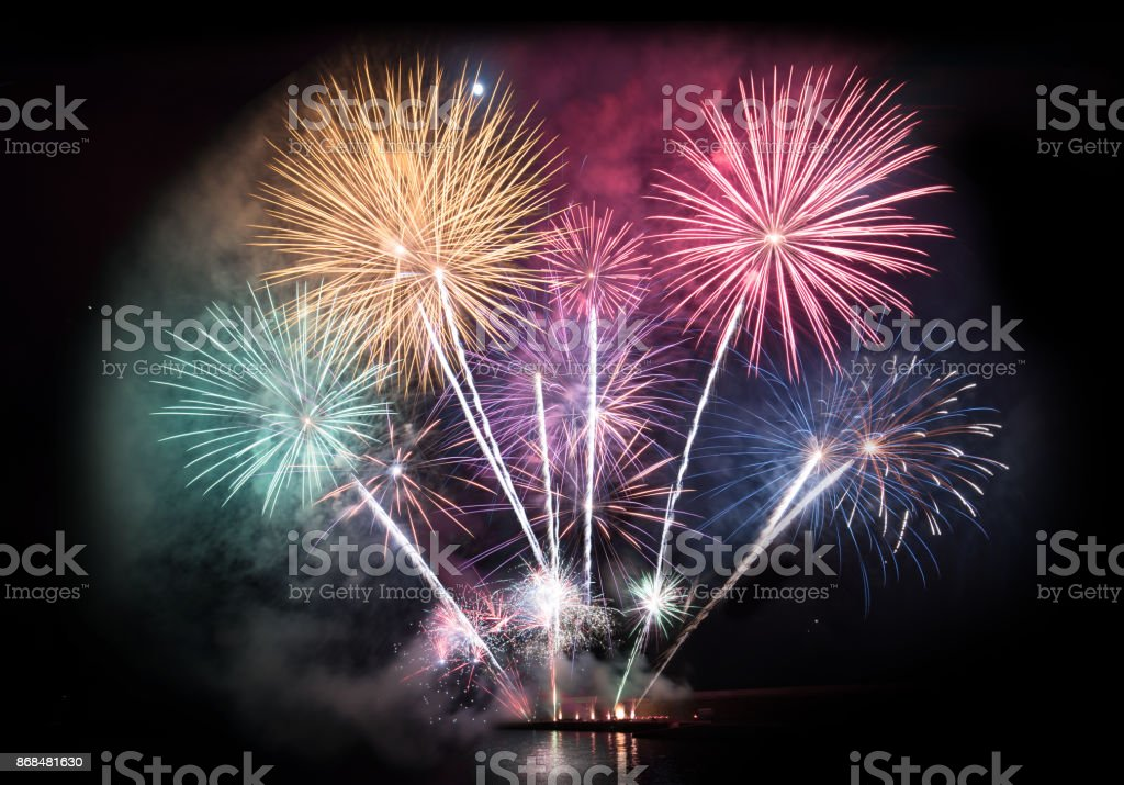 Colorful firework display for celebration stock photo