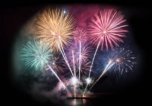 colorful firework display for celebration - fireworks stock pictures, royalty-free photos & images