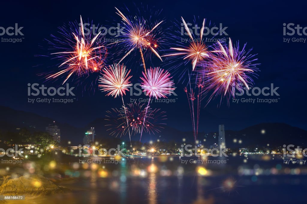 Colorful firework display in midnight sky over Andaman sea, Patong Beach, Phuket,Thailand Colorful firework display over city on the beach. Backgrounds Stock Photo