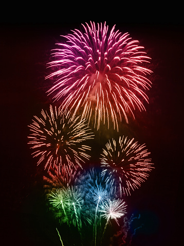 Colorful firework display, isolated on black background.