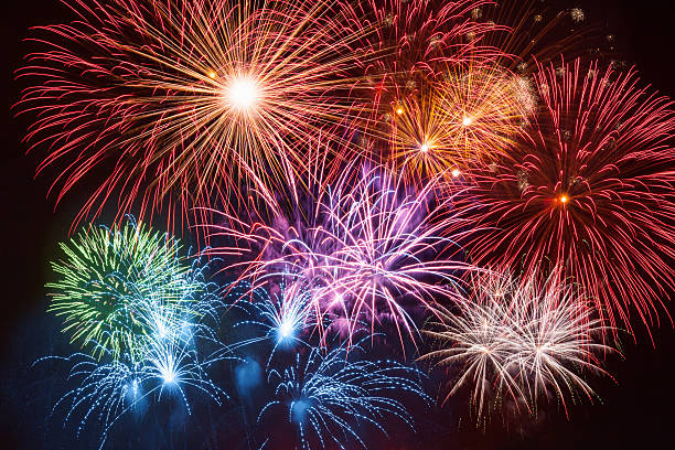colorful firework on night sky - firework display stock pictures, royalty-free photos & images