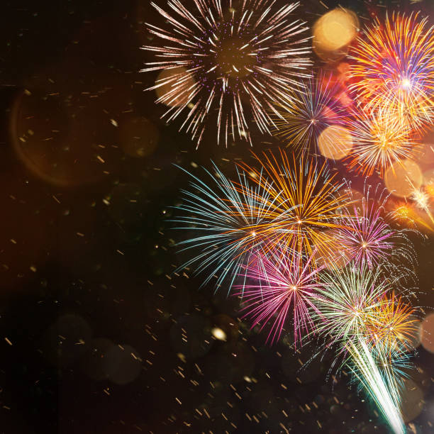Colorful firework with bokeh background. New Year celebration. stock photo