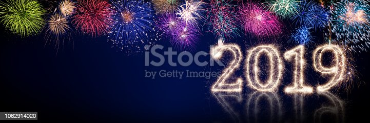 977840698 istock photo colorful fireworks and bright sparkler pyrotechnic number 2019 happy new year 1062914020