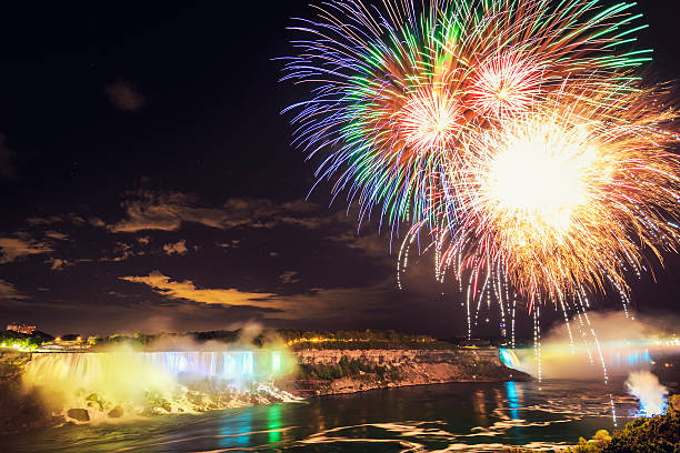 colorful fireworks at niagara falls night scene - niagara falls stock photos and pictures