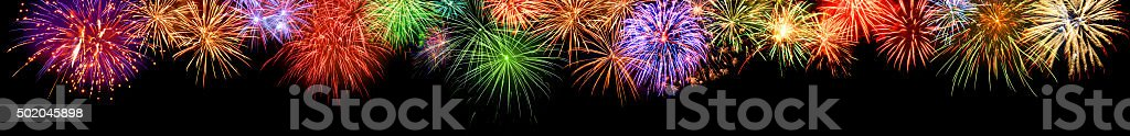 Colorful fireworks border, extra wide format stock photo