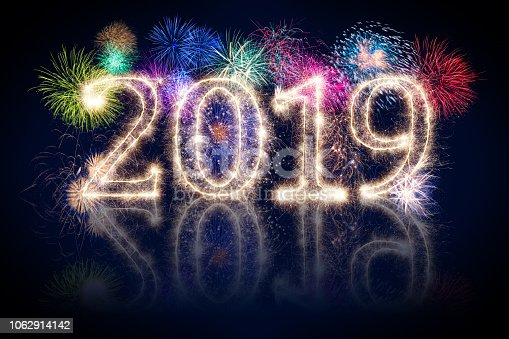977840698 istock photo colorful fireworks display and bright sparkler pyrotechnic number 2019 happy new year 1062914142