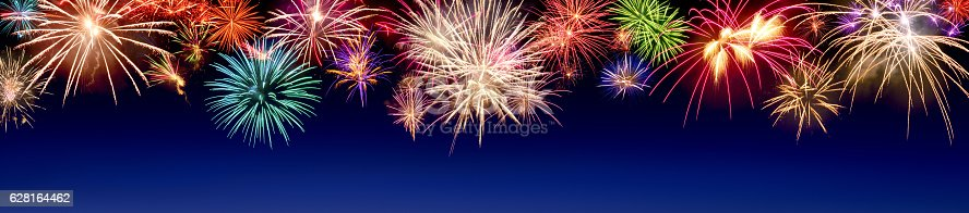 istock Colorful fireworks display on blue 628164462