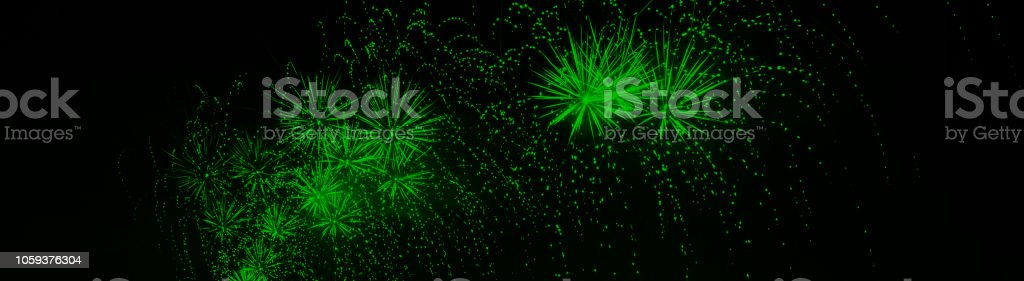 Colorful fireworks explosion in panorama format photo. Web banner. stock photo