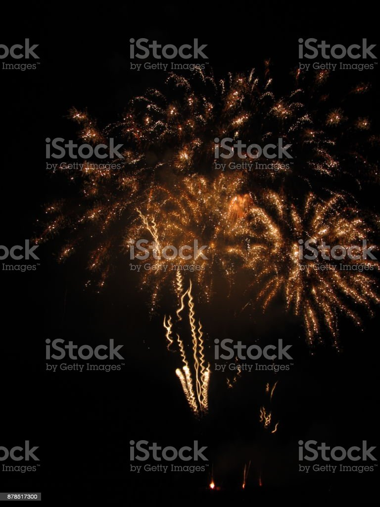 Colorful fireworks of various colors light up the night sky stock photo