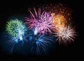 Colorful firework display in night sky.