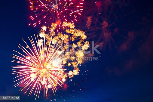 542714484 istock photo colorful fireworks on the black sky background 542714248