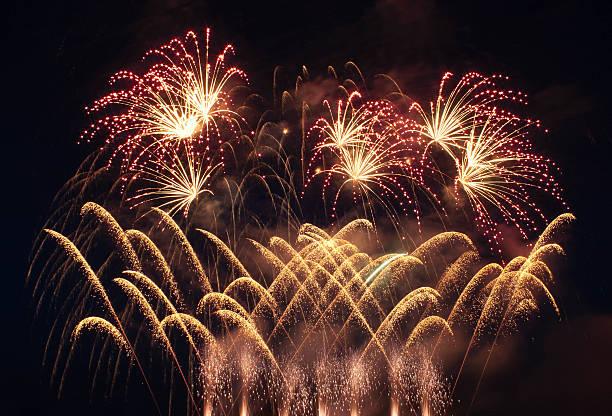 Colorful fireworks over dark sky stock photo