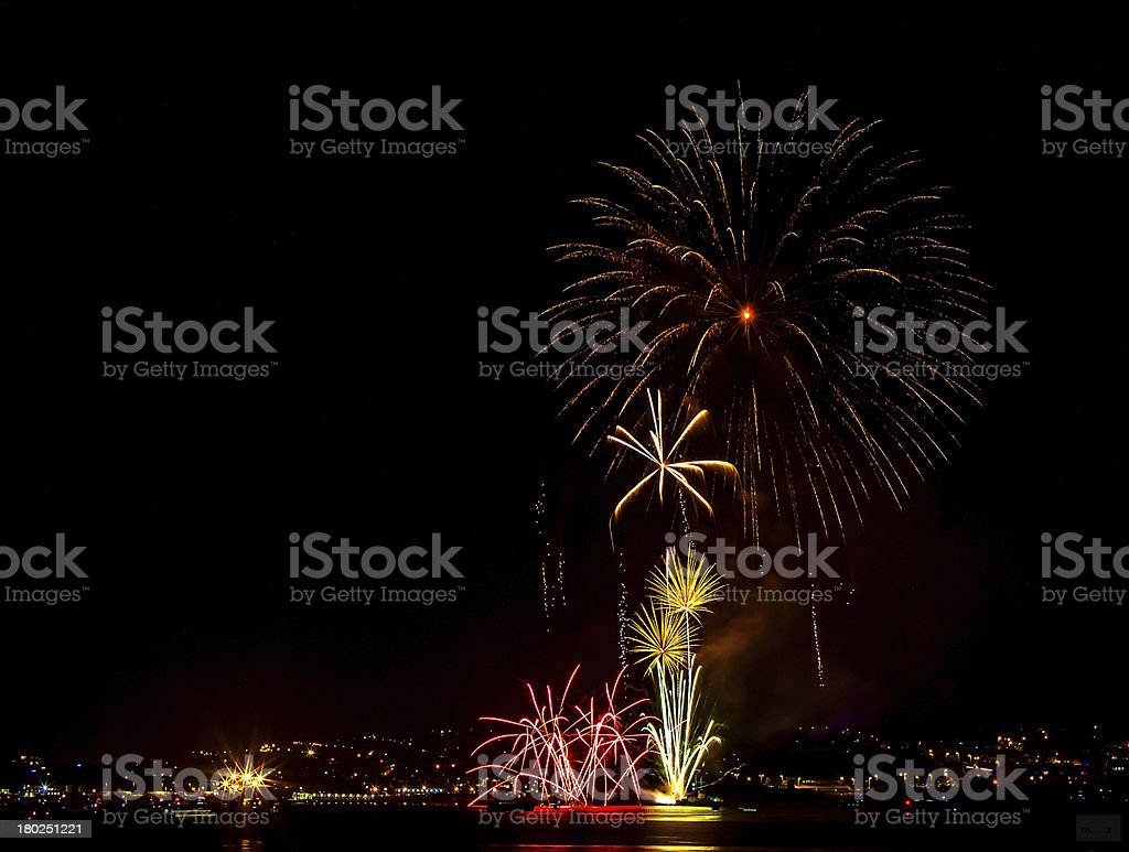 Colorful Fireworks over sea royalty-free stock photo