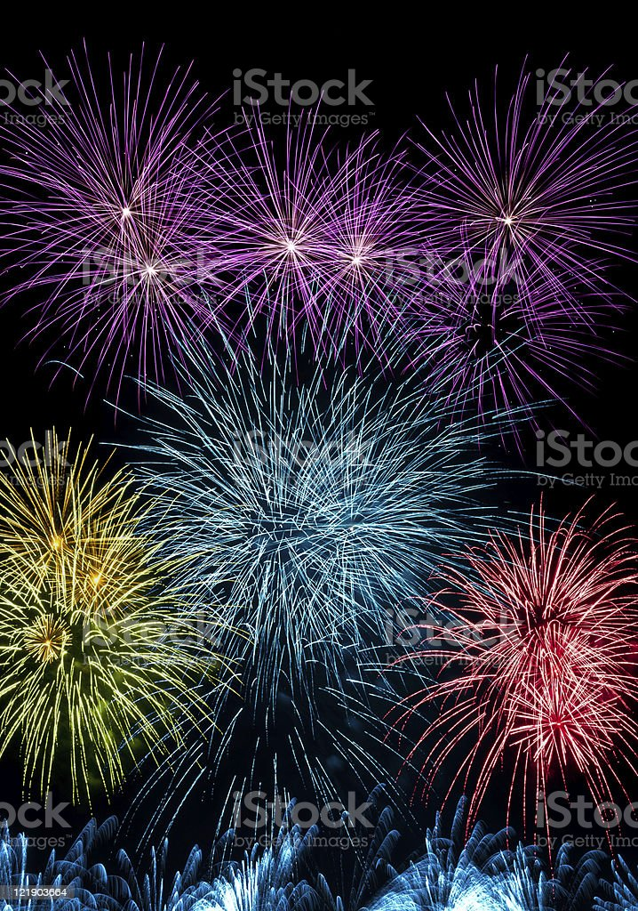 Colorful fireworks streaks in the night sky during international royalty-free stock photo