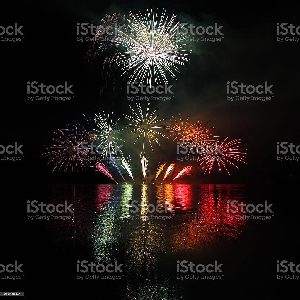 Colorful fireworks with reflection on lake. stock photo