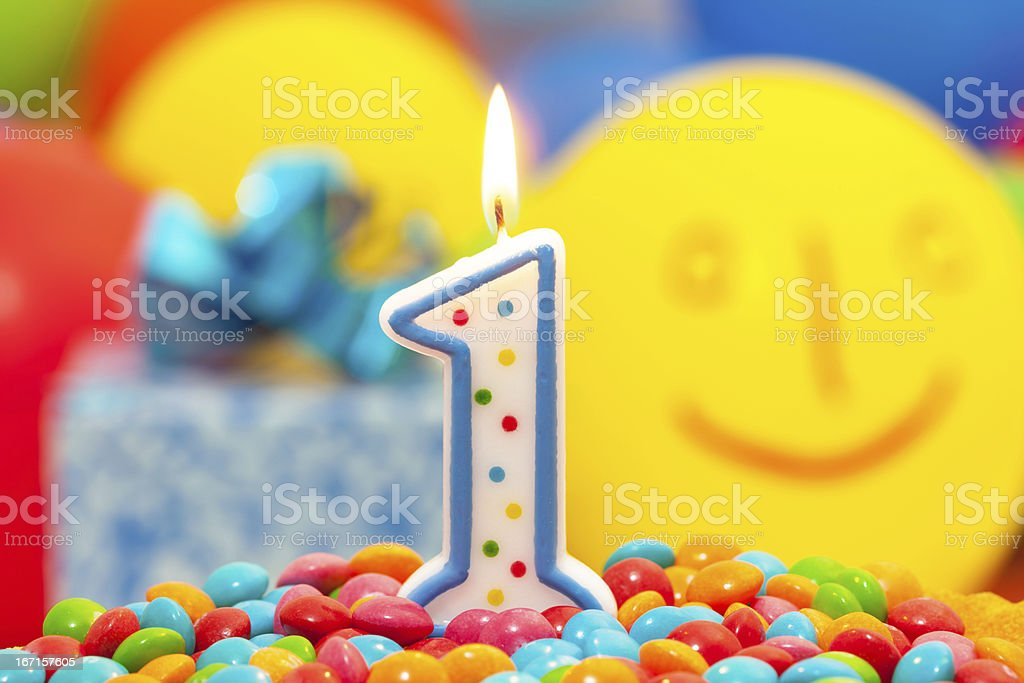 Colorful first birthday candle stock photo