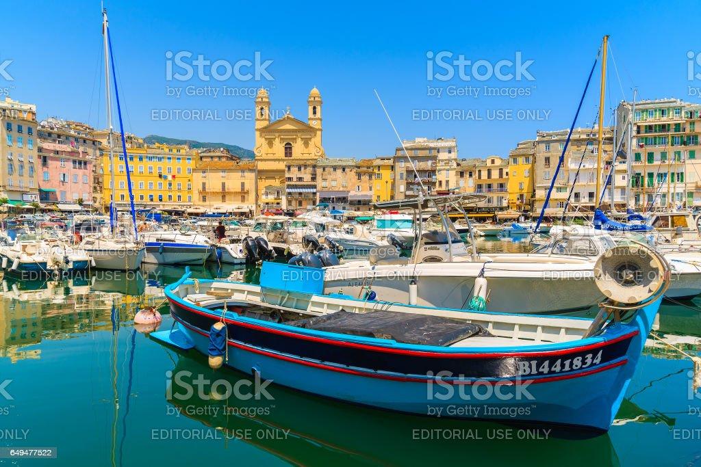 BASTIA PORT, CORSICA ISLAND - JUL 4, 2015: colorful fishing boat in Bastia harbour on sunny summer day, Corsica island, France. stock photo
