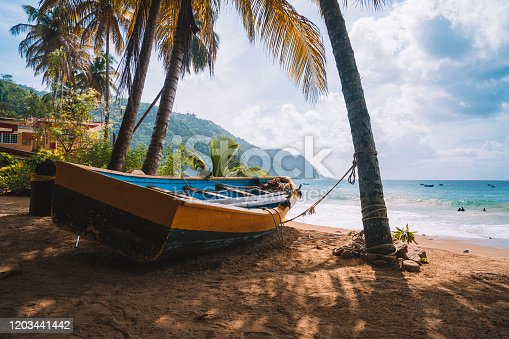 istock Colorful fishing boat near the transparent and clear turquoise water on a remote paradise island. 1203441442