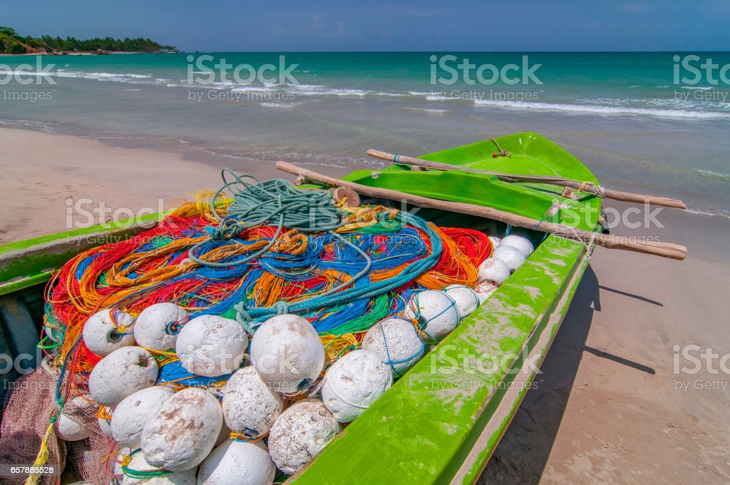 Colorful fishing boat on the beach. stock photo