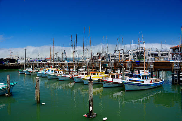 Colorful fishing boats at Fishermans Wharf of San Francisco Bay stock photo