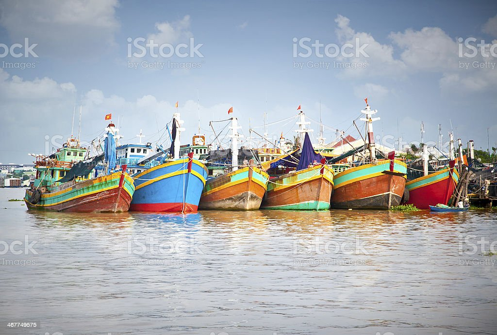 Colorful fishing boats in the Mekong Delta stock photo