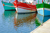 Colorful fishing boats in the port of Paimpol in Bretagne, France during summer.