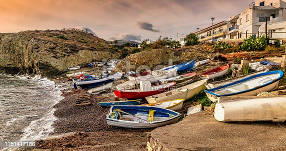 Picturesque fishing village scene with colorful fishing boats ashore in the Mediterranean coast of Cabo de Gata Natural Park, Spain.