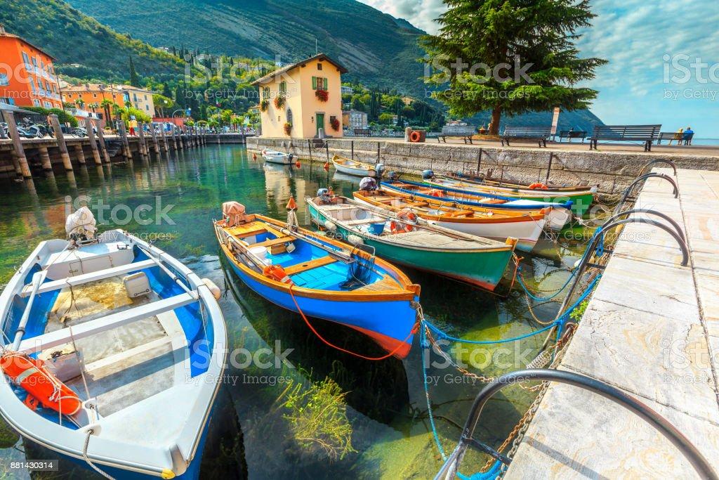 Colorful fishing boats on the Garda lake, Torbole, Italy, Europe stock photo