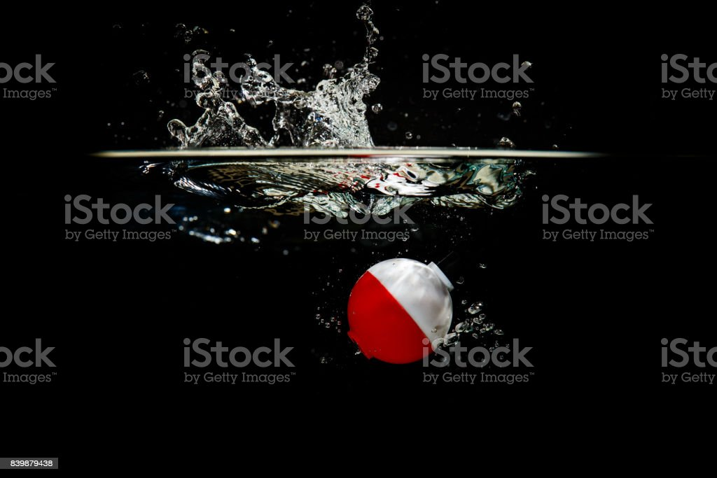 Colorful Fishing Bobber Makes a Splash stock photo