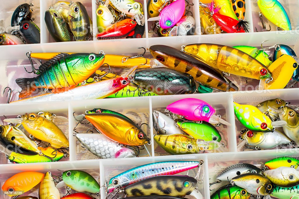 Colorful fishing lures and accessories in the box background stock photo
