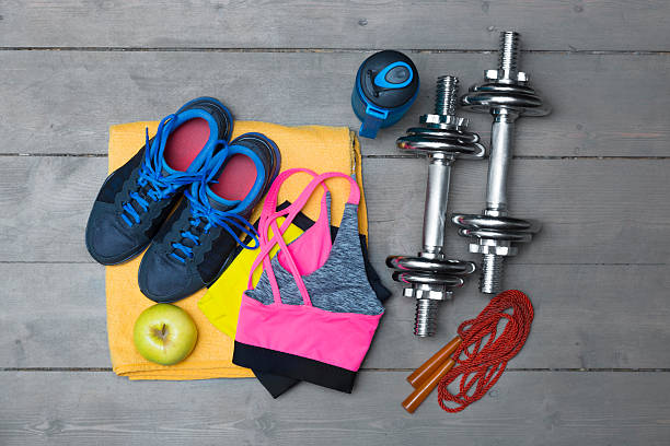 colorful fitness equipment on wooden floor stock photo