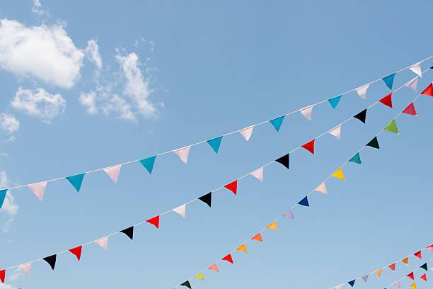 Colorful flags against blue sky (XXXLarge) stock photo