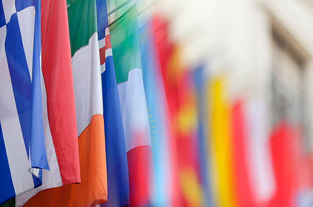 Colorful flags, blurred photo with copy space Colorful flags from various countries, blurred photo with copy space, Hofburg palace, Vienna, Austria diplomacy stock pictures, royalty-free photos & images
