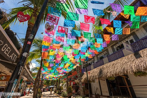 Puerto Vallarta, Mexico - September 2018: Colorful flags line a street in the town of Sayulita in Mexico.