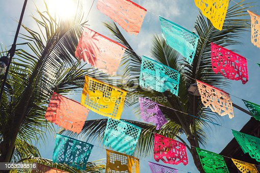 Colorful flags in the town of Sayulita in Mexico. Some flags have the towns name on them.